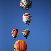 Hot Air balloons in the skies around rural Michigan near Battle Creek during competition in the 20th FAI World Hot Air Ballooning Championships. Battle Creek, Michigan, USA. 23rd August 2012. Photo Tim Clayton