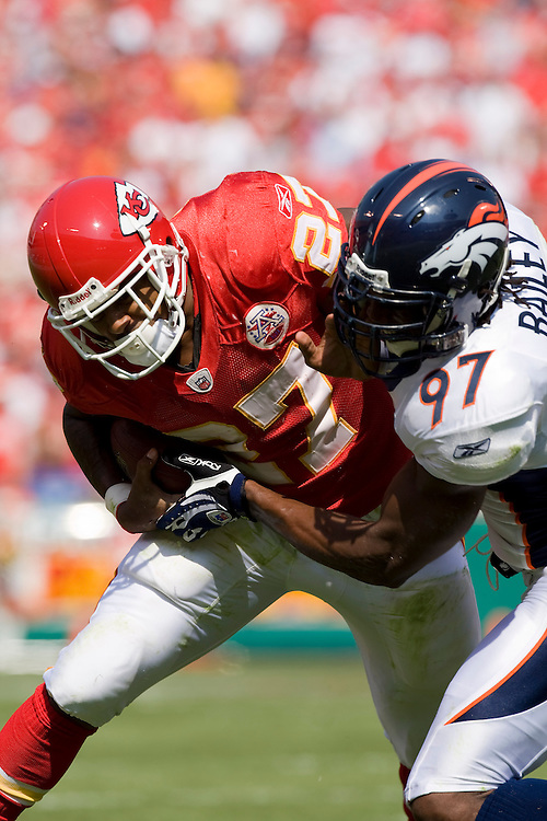 KANSAS CITY, MO - SEPTEMBER 28:   Larry Johnson #27 of the Kansas City Chiefs is tackled by Boss Bailey #97 of the Denver Broncos at Arrowhead Stadium on September 28, 2008 in Kansas City, Missouri.  The Chiefs defeated the Broncos 33-19.  (Photo by Wesley Hitt/Getty Images) *** Local Caption *** Larry Johnson; Boss Bailey