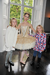 Left to right, ANASTASIA PENDLEBURY, a ballerina and ANNABEL GOTTO at a children's tea party for the English National Ballet hosted by Mortons Private Members Club, Berkeley Square, London on 20th October 2011.