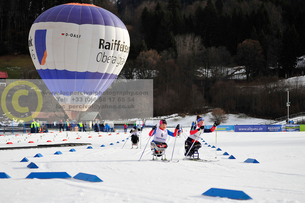 ABDIKARIMOVA Akzhana, RUS, McFADDEN Tatyana, USA, SEO Vo-Ra-Mi, KOR at the 2014 IPC Nordic Skiing World Cup Finals - Middle Distance