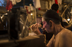 August 1, 2018 - Hong Kong - An actor of the Cantonese Opera waiting for the show to start outside a bamboo theater which will show traditional Cantonese Opera. (Credit Image: © Vernon Yuen/Pacific Press via ZUMA Wire)
