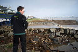 © Licensed to London News Pictures. 07/09/2013<br /> <br /> Saltburn, Cleveland, England<br /> <br /> An inspector from the Environment Agency looks on at damage caused to a bridge following an evening of torrential rainfall that caused flooding and disruption to Saltburn in Cleveland.<br /> <br /> Photo credit : Ian Forsyth/LNP