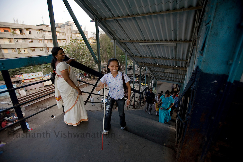 """Uma Phago enters the local train station to commute in Mumbai, Monday, April 17, 2008. (International Herald Tribune/Prashanth Vishwanathan) .Uma Phago.""""I never thought I would land such a good job until NAB gave me a call.saying I have been selected by CRSL. God has been gracious. My work at.CRSL has made my parents very proud as they feel that I'm on par with.the sighted."""".Designation: MT DoJ: 04-01-07Age: 25Education: HSC.."""