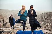 Hayat (left) teaches yoga to the residents of her village, Zataara,  on the outskirts of Bethlehem in the West Bank. The women are increasing in number each week.