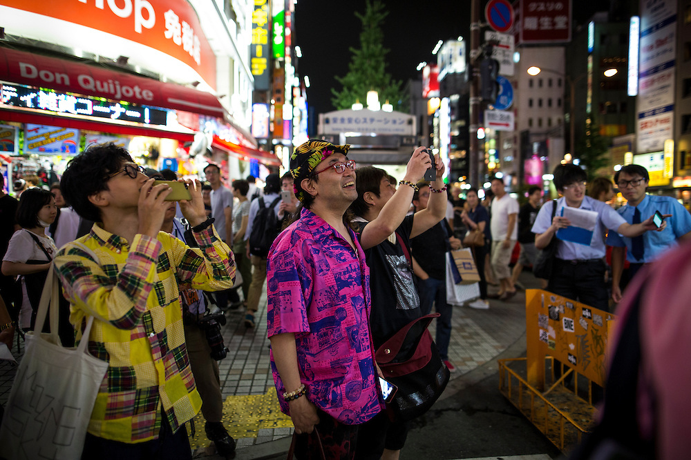 TOKYO, JAPAN - JULY 20 : People watch candidate Mac Akasaka deliver his campaign speech on stage for the July 31 Tokyo gubernatorial election in Shinjuku, Tokyo, Japan on Wednesday, July 20, 2016.   (Photo: Richard Atrero de Guzman/NUR Photo)
