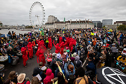 © Licensed to London News Pictures. 07/10/2019. London, UK. Climate change activists hold a protest blocking all traffic on Westminster Bridge, London, as part of a wider two week long demonstration to cause disruption in the capital. The activists are calling for the government to acknowledge and act on climate change. Photo credit : Tom Nicholson/LNP