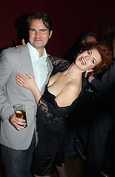 JIMMY CARR and CLEO ROCCOS at a party to celebrate the publication of Paul McKenna's new book 'I Can Make You Thin' held at the Soho Hotel, 4 Richmond Mews, London W1 on 8th March 2005.<br />
