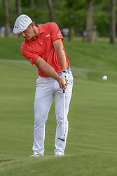 May 6, 2018 - Charlotte, NC, U.S. - CHARLOTTE, NC - MAY 06: Bryson DeChambeau hits an approach shot on the 14th hole during the final round of the Wells Fargo Championship on May 6, 2018 at Quail Hollow Club in Charlotte, NC. (Photo by William Howard/Icon Sportswire) (Credit Image: © William Howard/Icon SMI via ZUMA Press)