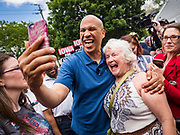 27 MAY 2019 - URBANDALE, IOWA: US Senator CORY BOOKER (D-NJ) takes selfies with people who came to a Memorial Day barbecue at his Iowa campaign headquarters. Sen. Booker is running to be the Democratic nominee for the US Presidency. Iowa traditionally hosts the the first selection event of the presidential election cycle. The Iowa Caucuses will be on Feb. 3, 2020.      PHOTO BY JACK KURTZ