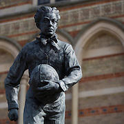"A statue of William Webb Ellis, credited with inventing the game of rugby stands outside of Rugby School in central England, March 18, 2015.  The public school, founded in 1567 was amongst the first ""Public"" schools in England. The school is known as the home of rugby. Local legend  states that in 1823 pupil William Webb Ellis first ran with the ball inventing the game of rugby football which took its name from the school. In 2015 20 countries will compete in the Rugby World Cup which is hosted by England REUTERS/Neil Hall"