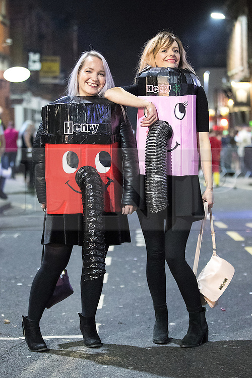 © Licensed to London News Pictures . 27/12/2016 . Wigan , UK . Two women wearing home-made Henry and Hetty vacuum cleaner costumes . Revellers in Wigan enjoy Boxing Day drinks and clubbing in Wigan Wallgate . In recent years a tradition has been established in which people go out wearing fancy-dress costumes on Boxing Day night . Photo credit : Joel Goodman/LNP