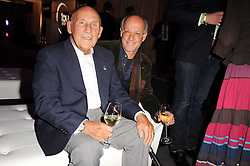 Left to right, SIR STIRLING MOSS and ROGER SAUL at a party to celebrate 150 years of TAG Heuer held at the car park at Selfridge's, London on 15th September 2010.