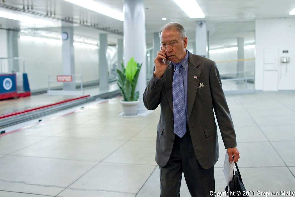 Senator Chuck Grassley (R-IA) talks on his cell phone as he walks towards the Senate floor before a vote in the United States Capitol building in Washington, D.C. on Thursday, June 23, 2011.