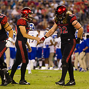 20 October 2018: San Diego State Aztecs place kicker John Baron II (29) is congratulated by teammate Parker Houston (82) after making a 36 yard field goal with sixteen seconds left in the half to give the Aztecs a 10-6 lead. The Aztecs beat the Spartans 16-13 Saturday night at SDCCU Stadium.
