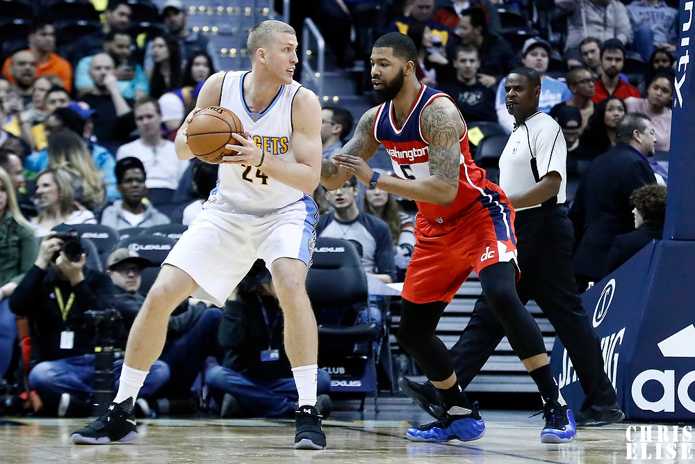 08 March 2017: Washington Wizards forward Markieff Morris (5) defends on Denver Nuggets center Mason Plumlee (24) during the Washington Wizards 123-113 victory over the Denver Nuggets, at the Pepsi Center, Denver, Colorado, USA.