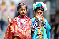 © Licensed to London News Pictures. 16/06/2019. London, UK. Chatanya Sharma aged 7 (L) dressed as Radha and Krsna Sharma aged 5 (L) dressed as Lord Krishna blows into a horn to produce a sound as Hare Krishna pilgrims and devotees celebrate the 51st anniversary event of Rathayatra, and the annual Krishna Chariot festival is celebrated all over the world. Rathayatra - the wooden chariots carrying deities of Jagannatha, Balarama and Subhadra which are pulled by hand by pilgrims and devotees. Photo credit: Dinendra Haria/LNP