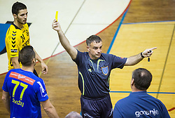 Referee Dusan Rizner (or Miran Tersek ?) with yellow card for Ivan Vajdl, head coach of Gorenje during handball match between RK Gorenje Velenje and RK Celje Pivovarna Lasko in Final match of 1st NLB League - Slovenian Championship 2013/14 on May 23, 2014 in Rdeca dvorana, Velenje, Slovenia. Photo by Vid Ponikvar / Sportida