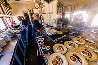 Preparing lunch in the kitchen of the luxury Rovos Rail train between Pretoria and Cape Town, South Africa.