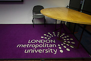 Logo on lecture threatre carpet of London Metropolitan University's Holloway Road.