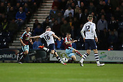 Alan Browne of Preston shot is blocked by Dean Marney of Burnley during the Sky Bet Championship match between Preston North End and Burnley at Deepdale, Preston, England on 22 April 2016. Photo by Simon Brady.
