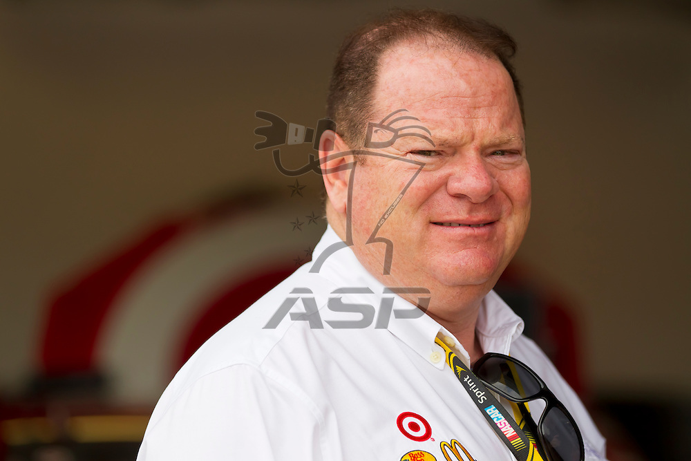 Daytona Beach, FL - Feb 18, 2012:  Car Owner, Chip Ganassi, watches a practice session for the Daytona 500 at the Daytona International Speedway in Daytona Beach, FL.