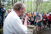 Barkley Marathons Race Director Lazarus Lake (Gary Cantrell) starts the 2012 race with the ceremonial lighting of the cigarette at the yellow gate.