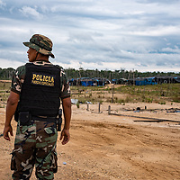 The Peruvian National Police near their field base, Mega 12. Following Peru's February 2019 militarized crackdown on illegal and unofficial alluvial gold mining in the La Pampa region of Madre de Dios, Wake Forest University's Puerto Maldonado-based Centro de Innovación Científica Amazonia (CINCIA), a leading research institution for the development of technological innovation for biological conservation and environmental restoration in the Peruvian Amazon, is applying years of scientific research and technical experience related to understanding mercury contamination and managing Amazonian ecosystems. What they learn will help guide urgent remediation, restoration, and reforestation efforts that can also serve as models for how we address the tropic's most dramatically devastated landscapes around the world. La Pampa, Madre de Dios, Peru.