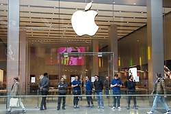 © Licensed to London News Pictures. 15/03/2020. London, UK. Staff members stand outside Apple store in Westfield Stratford shopping city as the store is closed until 27 March 2020 amid an increased number of coronavirus (COVID-19) cases in the UK. 21coronavirus victims have died and 820 cases have tested positive of the virus in the UK of which 167 in London. Photo credit: Dinendra Haria/LNP