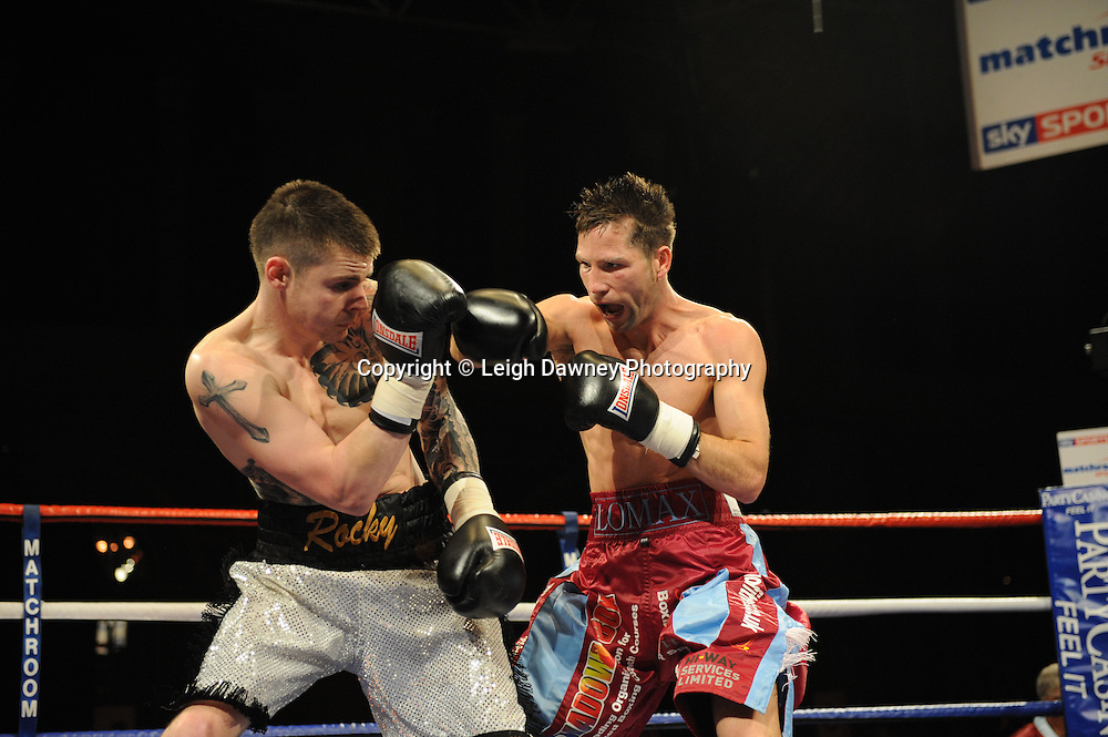 Michael Lomax defeats Dave Ryan (grey shorts) on the 9th April 2010 at Alexandra Palace, London. Matchroom Sport. Photo credit: © Leigh Dawney