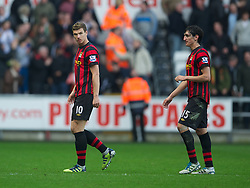 SWANSEA, WALES - Sunday, March 11, 2012: Manchester City's Edin Dzeko and Stefan Savic walk off dejected after losing 1-0 to Swansea City during the Premiership match at the Liberty Stadium. (Pic by David Rawcliffe/Propaganda)