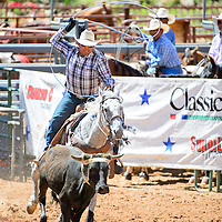 Kenny Livingston heads  for Joseph Savedra during the Red Rock Classic team roping competition Saturday at Red Rock Park in Church Rock.