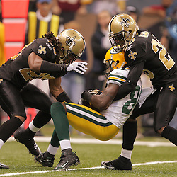 2008 November, 24: New Orleans Saints defenders Usama Young (28) and Randall Gay (20) combine to tackle Green Bay Packers wide receiver Donald Driver (80) during a Monday Night Football game between the Green Bay Packers and the New Orleans Saints at the Louisiana Superdome in New Orleans, LA.