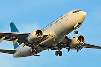 Westjet Boeing 737-700 making a sunset landing into Vancouver (CYVR)