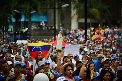 June 17, 2017 - Caracas, Capital District, Venezuela - Opposition protesters protested in Caracas, Venezuela this June 17, 2017. Venezuelan opposition focused on Parque Cristal in a religious protest to pray for peace and pay homage to those killed during protests against the Nicolas Maduro government. (Credit Image: © Adrian Manzol via ZUMA Wire)