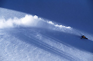 Snowboarder turning in fresh powder snow, Cerro Castor, Tierra del Fuego, Argentina