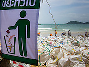 """02 AUGUST 2013 - KOH SAMET, RAYONG, THAILAND: A """"no littering"""" sign on Ao Prao beach on Koh Samet island where workers are cleaning up the beach after it was fouled by an oil spill. About 50,000 liters of crude oil poured out of a pipeline in the Gulf of Thailand over the weekend authorities said. The oil made landfall on the white sand beaches of Ao Prao, on Koh Samet, a popular tourist destination in Rayong province about 2.5 hours southeast of Bangkok. Workers from PTT Global, owner of the pipeline, up to 500 Thai military personnel and volunteers are cleaning up the beaches. Tourists staying near the spill, which fouled Ao Prao beach, were evacuated to hotels on the east side of the island, which was not impacted by the spill. Officials have not said when Ao Prao beach would reopen. PTT Global Chemical Pcl is part of state-controlled PTT Pcl, Thailand's biggest energy firm.    PHOTO BY JACK KURTZ"""