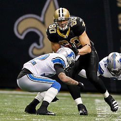 January 7, 2012; New Orleans, LA, USA; New Orleans Saints tight end Jimmy Graham (80) is tackled by Detroit Lions cornerback Aaron Berry (32) and linebacker Justin Durant (52) during the 2011 NFC wild card playoff game at the Mercedes-Benz Superdome. Mandatory Credit: Derick E. Hingle-US PRESSWIRE