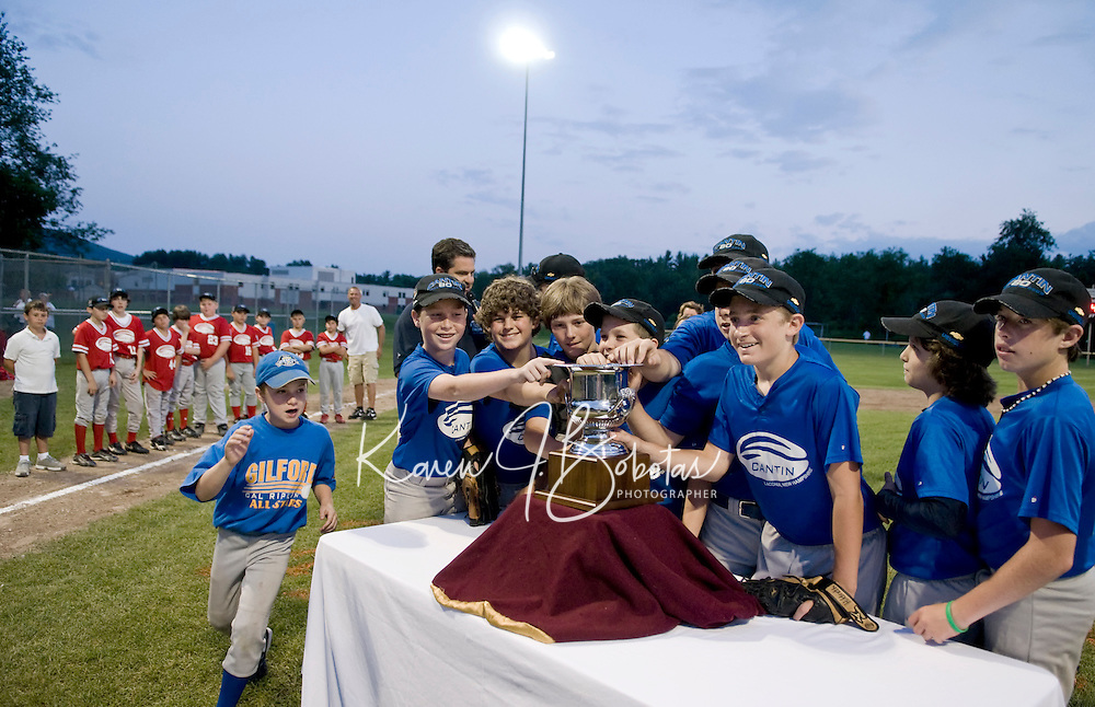 "Gilford Cal Ripken's Team Cantin takes the coveted ""Cantin Cup"" during the first annual matchup of Laconia Little League and Gilford Cal Ripken Saturday evening under the lights at Francouer Field with a final score of 4-1.  (Karen Bobotas/for the Laconia Daily Sun)"