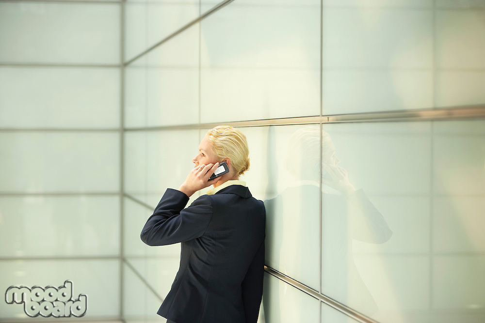 Businesswoman Using Cell Phone side view
