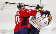 Buffalo Sabres left wing Tyler Ennis (R) takes a punch from Washington Capitals left wing Troy Brouwer (L) during the third period of their NHL hockey game in Washington.