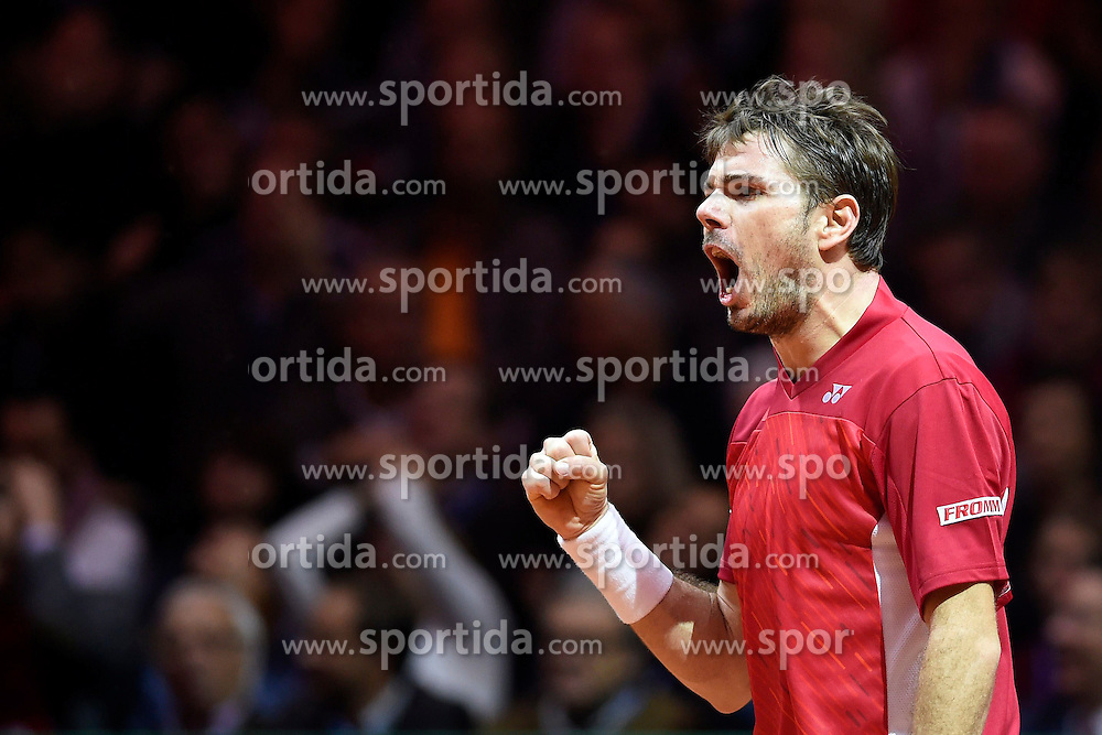 21.11.2014, Stade Pierre Mauroy, Lille, FRA, Davis Cup Finale, Frankreich vs Schweiz, im Bild Stanislas Wawrinka (SUI) jubelt // during the Davis Cup Final between France and Switzerland at the Stade Pierre Mauroy in Lille, France on 2014/11/21. EXPA Pictures &copy; 2014, PhotoCredit: EXPA/ Freshfocus/ Valeriano Di Domenico<br /> <br /> *****ATTENTION - for AUT, SLO, CRO, SRB, BIH, MAZ only*****