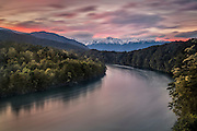 A tinge of salmon reflects off the Waiau River at sunset, in Fiordland, New Zealand.