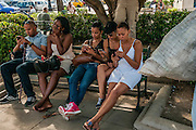 Cienfuegos, Cuba.Connecting to the internet in the city square