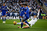 Leicester City defender Ben Chilwell (3) is tackled by Burnley's Matthew Lowton during the Premier League match between Leicester City and Burnley at the King Power Stadium, Leicester, England on 10 November 2018.