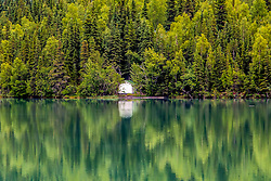 Time for reflection alone on the lake.  This lone cabin sits surrounded by beautiful trees.