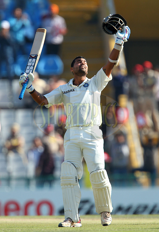 Murali Vijay of India celebrates his century during day 4 of the 3rd Airtel Test Match between India and Australia held at the PCA Stadium, Mohali, India on the 17th March 2013..Photo by Ron Gaunt/BCCI/SPORTZPICS ..Use of this image is subject to the terms and conditions as outlined by the BCCI. These terms can be found by following this link:..http://www.sportzpics.co.za/image/I0000SoRagM2cIEc