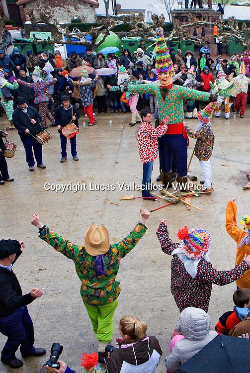 Txatxos dancing the Zortziko dance, and Miel Otxin.In Frontón´. Lantz carnival. Navarra. Spain