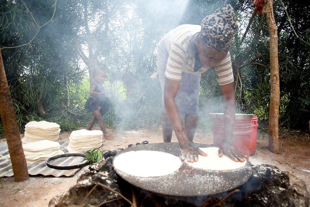 A Fonkoze microcredit client makes casave bread as part of her new microenterprise.