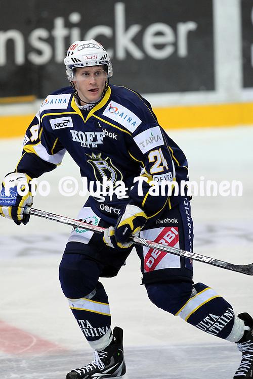 25.09.2010, Barona Areena, Espoo..J??kiekon SM-liiga 2010-11..Blues - K?rp?t..Jani Lajunen - Blues.©Juha Tamminen.