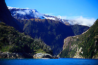 Milford Sound on the South Island of New Zealand is famous for its towering mountain peaks surrounding a narrow gorge.
